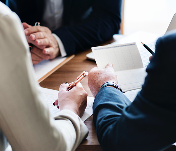 Individuals discussing investment banking with an advisor